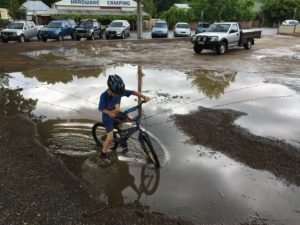 There's something about puddles that kids are just drawn to. Let 'em go, I say.